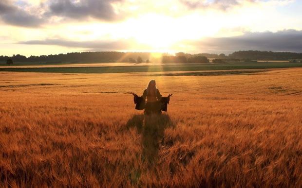 happy-woman-in-golden-wheat-field
